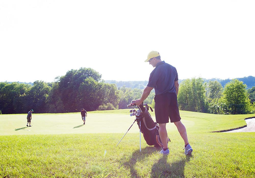 Men playing golf on a sunny day at Braestone Club | Braestone Club Gallery