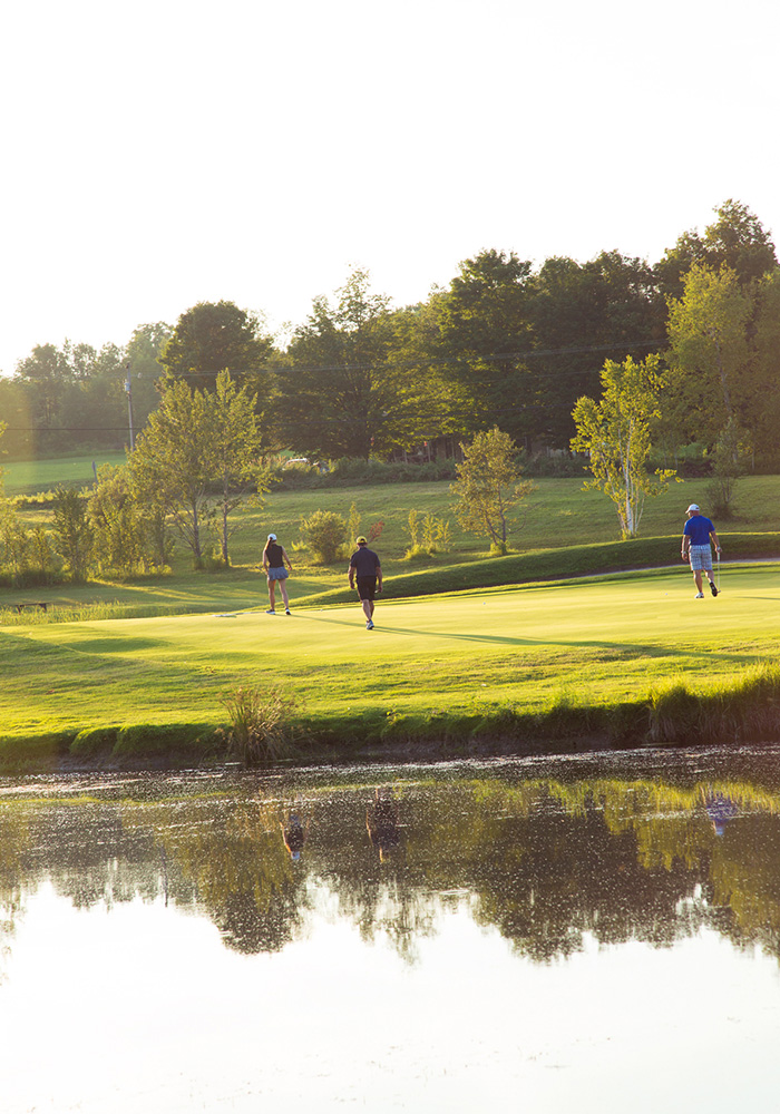 Woman and two men playing golf at Braestone Club | Braestone Club Gallery